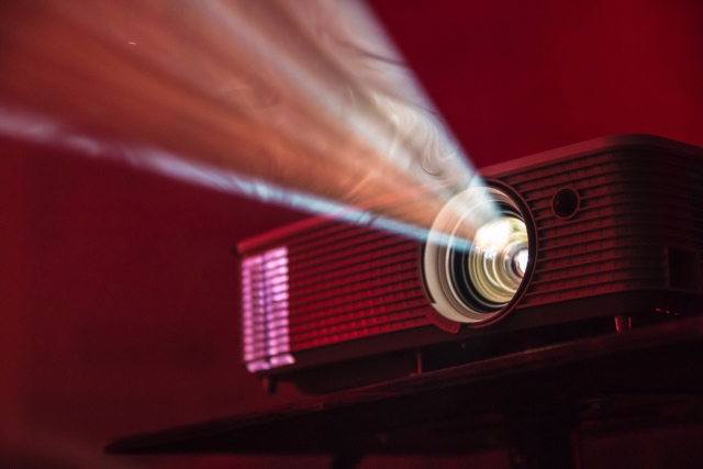 content projector in red with swirling light