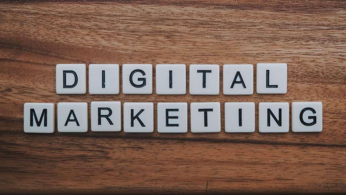 digital marketing in scrabble tiles on a wooden table